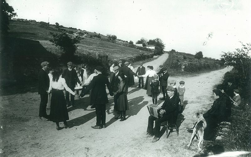 phot of a group of people dancing in Co. Cork, 100 years ago